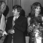 "Photo: Italian director Michelangelo Antonioni, right, is the guest of honor at a swinging Hollywood party which included, left to right, actors Rex Harrison, Vanessa Redgrave and David Hemmings. The latter two star in ""Blow Up,"" which Antonioni directed as his first English language film. Party was in studio of a photographer, recreating Mod Ball scene from the film. 14.12.1966"