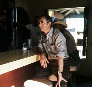 "Al bar. Danny Lyon USA. California. 1968. Michelangelo ANTONIONI during the making of his film ""Zabriskie Point."""