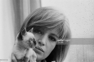 Italian actress Monica Vitti holding a kitten in Rome, Italy, 28th March 1965